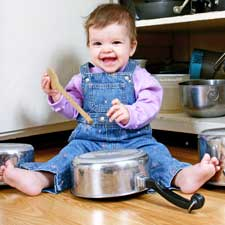 Baby banging pots and pans